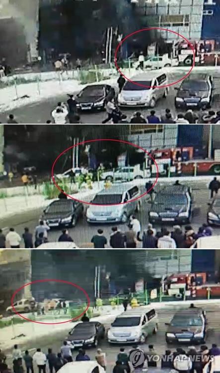 移動される車両(赤い丸)が写った防犯カメラの映像=22日、堤川(聯合ニュース)