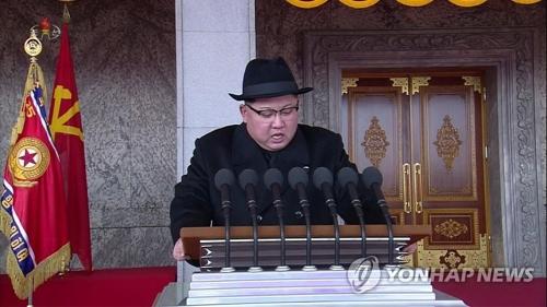 軍事パレードで演説する金正恩氏。朝鮮中央テレビが放映した=8日、ソウル(朝鮮中央テレビ=聯合ニュース)