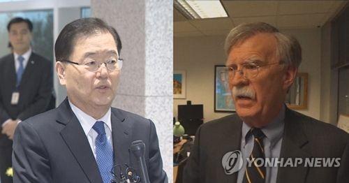 鄭氏(左)とボルトン氏(聯合ニュースTV提供)=(聯合ニュース)