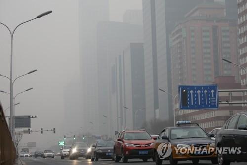 스모그로 뿌연 베이징 시내.[연합DB]