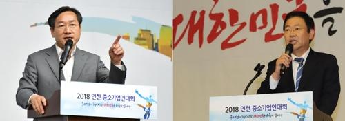 유정복 후보(왼쪽)와 박남춘 후보