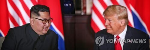 단독회담하는 김정은 위원장과 트럼프 대통령 [싱가포르 통신정보부 제공=연합뉴스]
