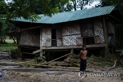 댐 사고에 따른 홍수로 처참하게 부서진 민가[AFP=연합뉴스]