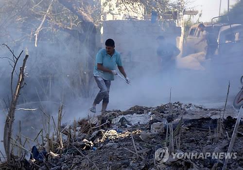 4일 러시아군의 공습을 받은 이들립 주택가[AFP=연합뉴스자료사진]