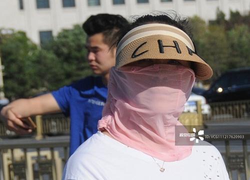 '스모그 악명' 中베이징, 꽃가루·강풍 이어 폭염까지 엄습