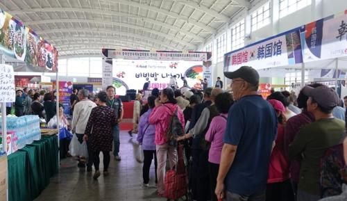 中 선양농업박람회서 500인분 비빔밥 비벼 관람객들에 제공