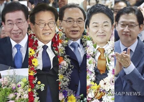 Los candidatos del gobernante Partido Democrático disfrutan de su victoria en las elecciones locales del 13 de junio del 2018.