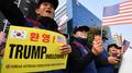 韩青瓦台称特朗普因天气取消访问非军事区