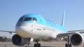 韩客机昨从威海出发前因雪滑出跑道 无人伤亡
