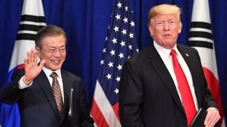 """""""평화의 새 시대"""" vs """"갈 길 먼 비핵화"""""""