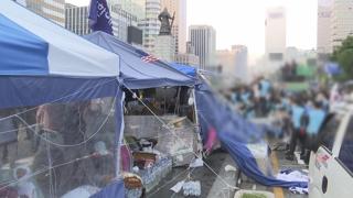 '애매한 법'에 막힌 불법천막 강제철거