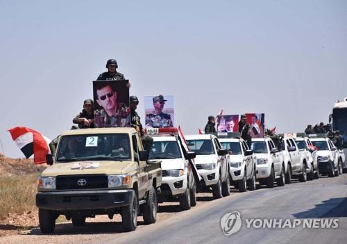 홈스 북부의 시리아군 차량 행렬
