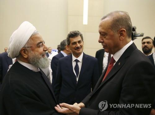 OIC 긴급 정상회의서 만난 이란-터키 대통령