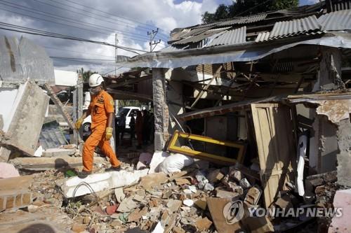 资料图片:印尼地震灾区现场(韩联社/美联社)