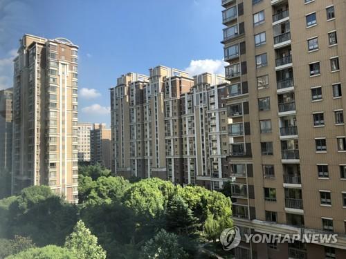 中 '부동산 불황' 쇼크…관련기업 주가 하루 80% 폭락