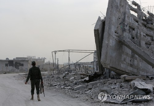 파괴된 동구타에 진입한 시리아군