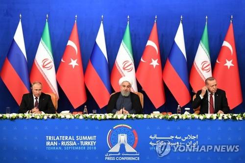 테헤란서 러시아(왼쪽)·이란(가운데)·터키 정상회의