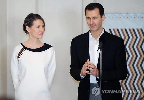 아사드 시리아 대통령(오른쪽)과 부인 아스마
