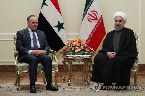 하산 로하니 이란 대통령(오른쪽), 이마드 카미스 시리아 총리 면담