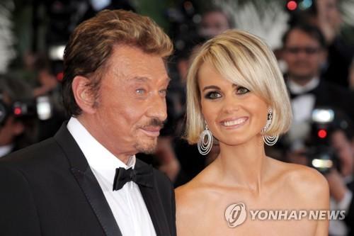 2009년 칸 영화제 참석한 조니 알리데와 그의 부인 레티시아