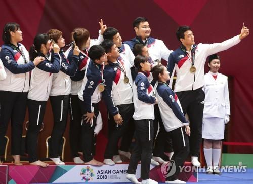 雅加达亚运上的韩朝柔道联队(韩联社/欧新社)