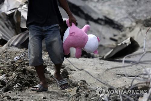 인도네시아, 지진으로 폐허가 된 팔루 페토보 마을