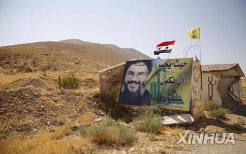 시리아 서부 깔라문에 붙은 헤즈볼라 최고지도자 포스터