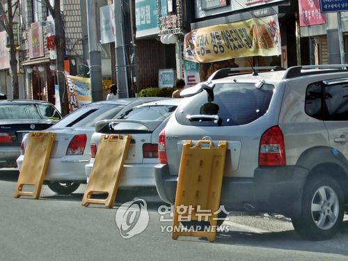 차량 번호판 가린 얌체 택배기사 경찰관 폭행해 벌금형