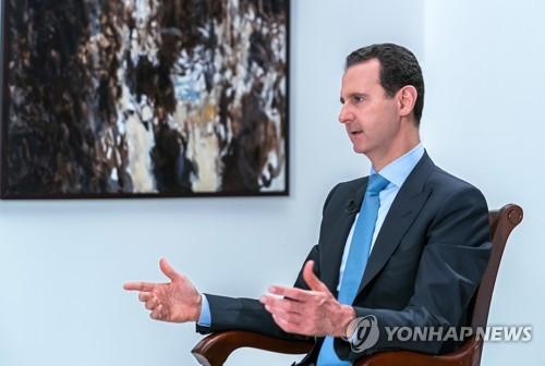 이란 TV와 인터뷰하는 아사드 시리아 대통령