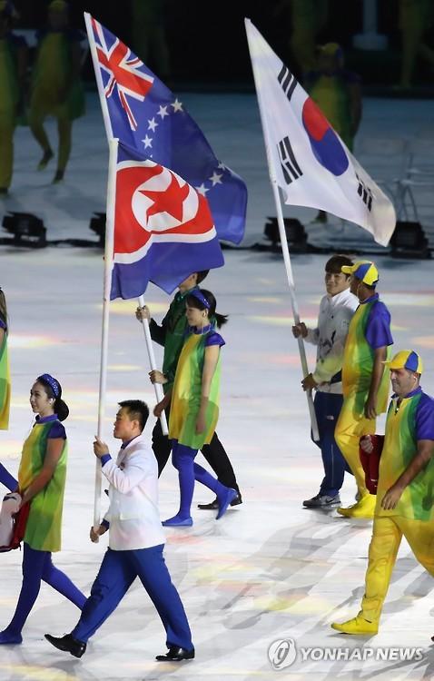 Porte-drapeau sud-coréen et nord-coréen