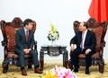 韩联社社长和越南总理交谈