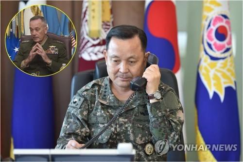 资料图片:右为韩国联参议长李淳镇,左为美国参谋长联席会议主席约瑟夫・邓福德。(韩联社/韩国联参提供)