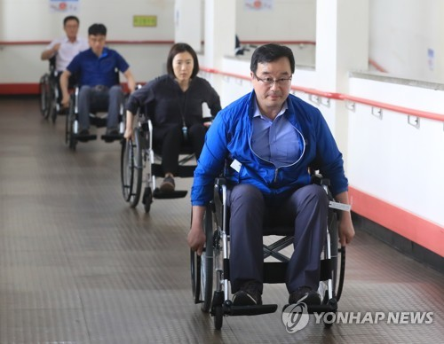 Public officials on wheelchairs
