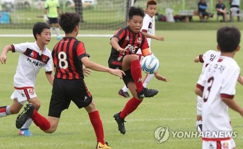 [연합뉴스 자료사진] 유소년 축구선수들의 경기 모습