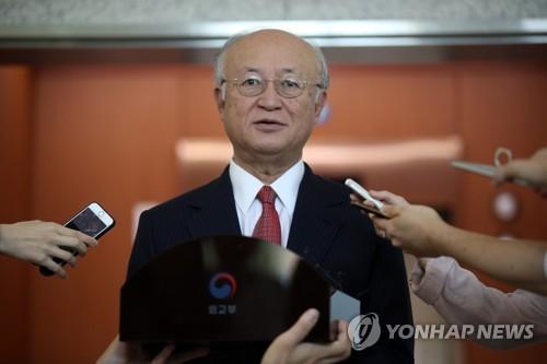 韓国外交部長官との会談後、質問に答える天野氏=29日、ソウル(聯合ニュース)