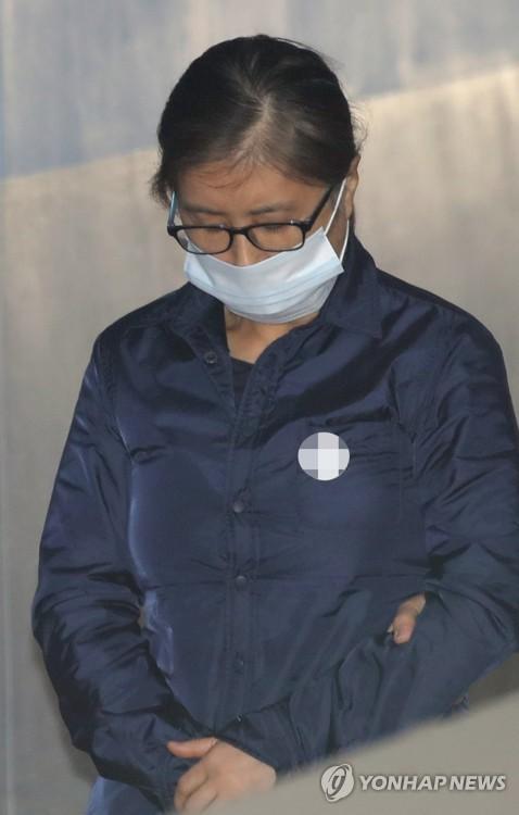 韩亲信门主角崔顺实出庭受审