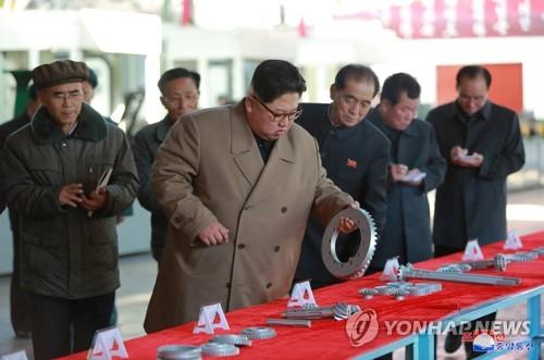 Kim Jong-un at tractor factory