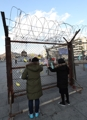 Barbed wire fence from DMZ relocated to downtown Seoul