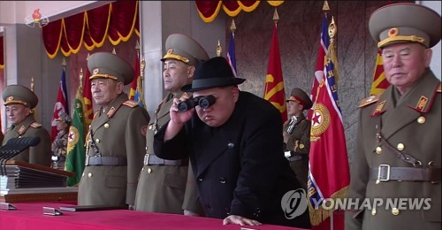 N.K. holds military parade