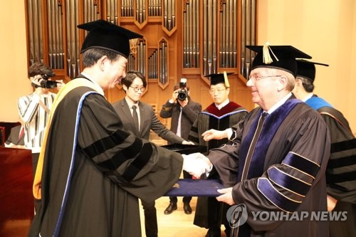 IOC chief receives honorary doctorate degree