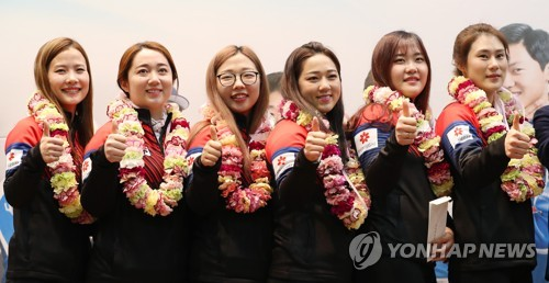 This file photo taken on March 12, 2018, shows the South Korean women's curling team posing for a group photo at an event in North Gyeongsang Province after it won a silver medal at the 2018 PyeongChang Winter Olympics. From left are Kim Eun-jung, Kim Yeong-mi, Kim Seon-yeong, Kim Kyeong-ae, Kim Cho-hee and head coach Kim Min-jung. (Yonhap)