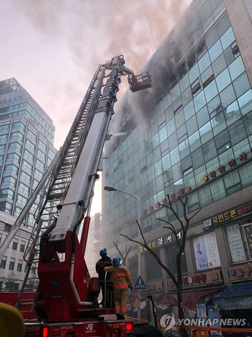 Fire erupts at commercial building