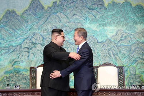 In this photo taken on April 27, 2018, South Korean President Moon Jae-in (R) and North Korean leader Kim Jong-un embrace each other after signing their joint declaration on complete denuclearization of the Korean Peninsula at the end of their first-ever inter-Korean summit held at the border village of Panmunjom. (Yonhap)