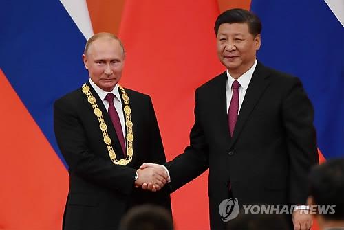 시진핑, 푸틴에 '우의훈장' 수여