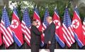 朝美领导人历史性握手