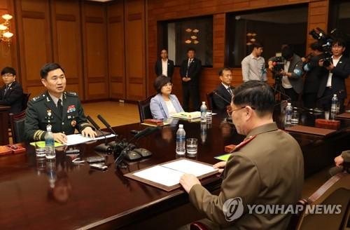 공동보도문 발표하는 김도균 수석대표