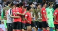 South Korean players console one another after loss
