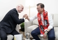 Avec le chef de la Fifa