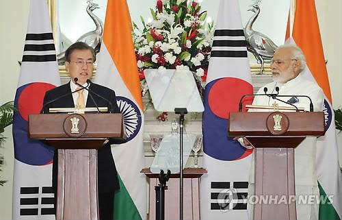 韩印首脑发表会谈成果