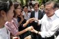 Avec des ressortissants sud-coréens à Singapour